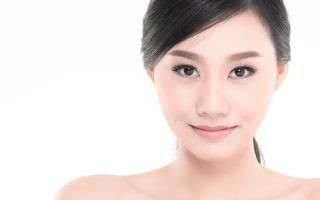 Beautiful Young Asian Woman with Clean Fresh Skin look away, Girl beauty face care. Facial treatment, Cosmetology, beauty and spa.